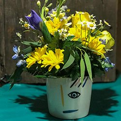 flower-arrangement-with-eye-on-pot-vase