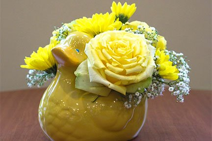 yellow floral arrangement in a duck