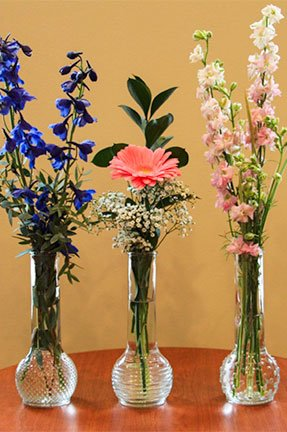 3 vases with assorted flowers