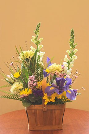 assorted flowers in a basket